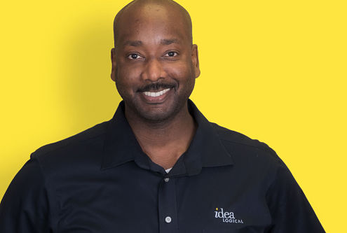 Man in front of yellow background